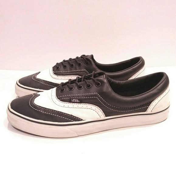 8d442e298b Van s black and white wingtip sneaker size 11.5. M 5ab837f805f43044a0bb7296